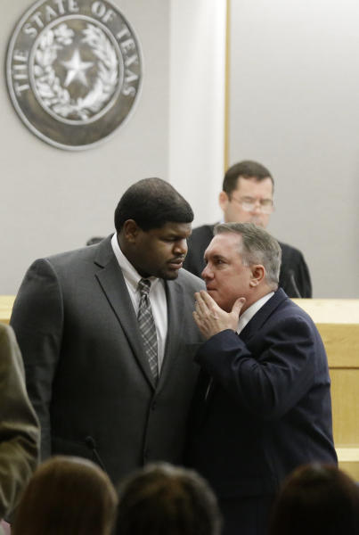 Former Dallas Cowboys' Josh Brent, left, talks with his attorney George Milner during juror selection Friday, Jan. 10, 2014, in Dallas. Jury selection continues for the upcoming trial of Brent, who's accused of killing a practice squad player in a drunken-driving wreck. Opening statements in the case are expected next week. (AP Photo/LM Otero)