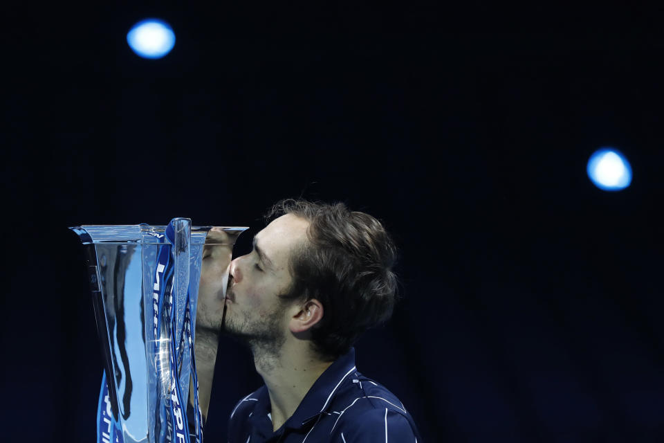 Daniil Medvedev of Russia kisses the winners trophy after defeating Dominic Thiem of Austria in the final of the ATP World Finals tennis match at the ATP World Finals tennis tournament at the O2 arena in London, Sunday, Nov. 22, 2020. (AP Photo/Frank Augstein)
