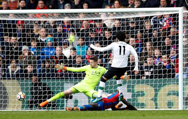 Liverpool's Mohamed Salah scores the winner at Crystal palace on Saturday. (Reuters)