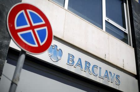 """A """"no parking"""" road sign is seen in front of a Barclays branch in downtown Rome"""