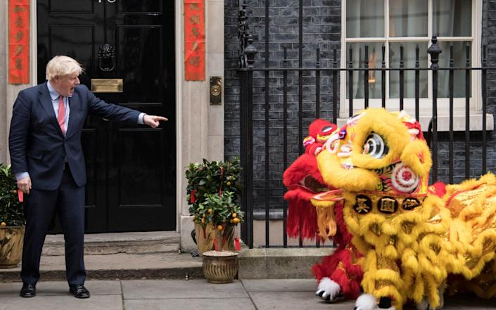Boris Johnson welcomes members of the Chinese community at 10 Downing Street, London, in celebration of the Chinese New Year, earlier this year
