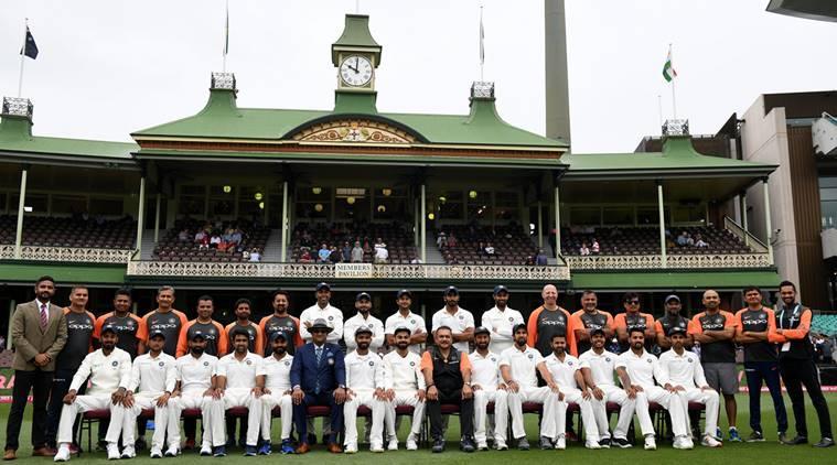 The Indian cricket team and staff pose for a photograph ahead of play on day five of the fourth test match between Australia and India at the SCG in Sydney, Australia