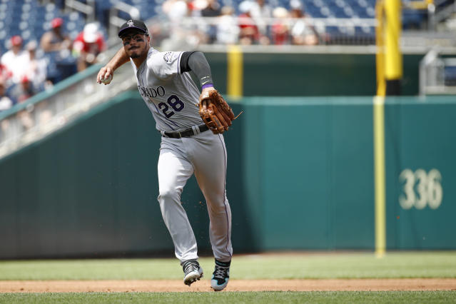 Colorado Rockies third baseman Nolan Arenado throws out Washington Nationals' Trea Turner at first base in the third inning of the first baseball game of a doubleheader, Wednesday, July 24, 2019, in Washington. (AP Photo/Patrick Semansky)