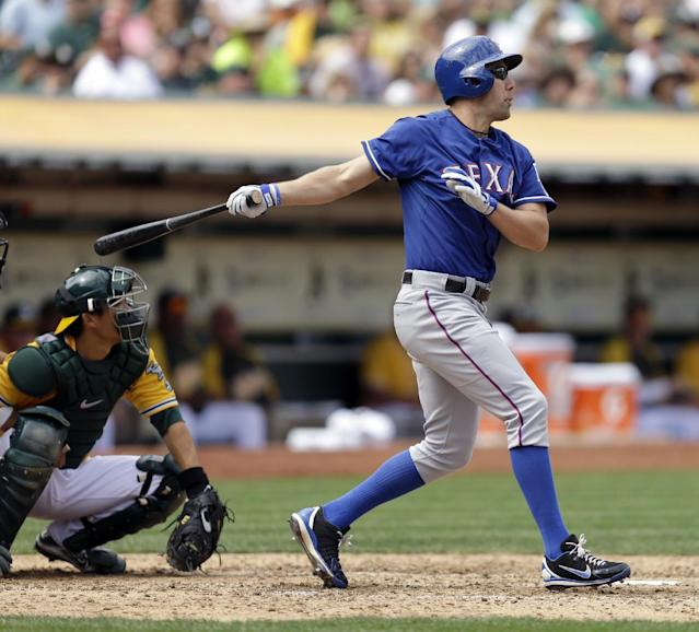 Texas Rangers' David Murphy swings for a two run home run off Oakland Athletics' Dan Straily in the fifth inning of a baseball game, Monday, Sept. 2, 2013, in Oakland, Calif. (AP Photo/Ben Margot)