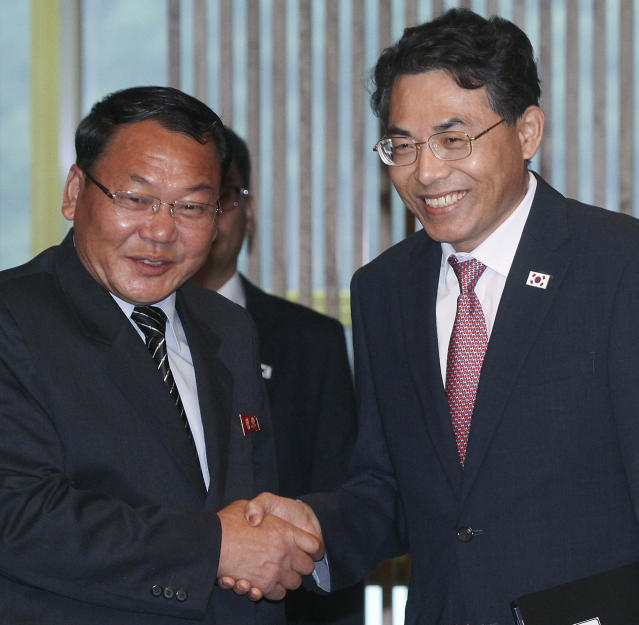 North Korean Vice Railroad Minister Kim Yun Hyok, left, shakes hands with his South Korean counterpart vice Transport Minister Kim Jeong-ryeol upon his arrival to hold a meeting to discuss over inter-Korean cooperation in railway inside the Peace House at the border village of Panmunjom, South Korea, Tuesday, June 26, 2018. (Korea Pool via AP)