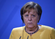 """German Chancellor Angela Merkel speaks during a press conference at the """"G20 Compact with Africa"""" (CwA) meeting at the Chancellery in Berlin, Friday, Aug. 27, 2021. (Tobias Schwarz/Pool Photo via AP)"""