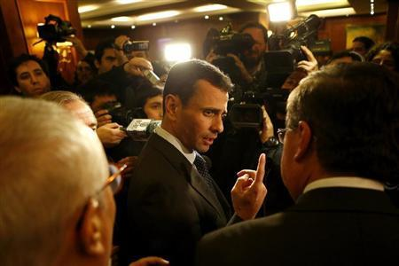 Capriles, Venezuela's opposition leader and governor of Miranda state, talks with the media as he attend a meeting with members of Chilean right-wing alliance in Santiago