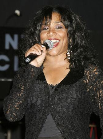 FILE PHOTO: One of the original members of the music group 'Sister Sledge' Joni Sledge performs  'We Are Family' at the CD launch party for the 'We Are Family' CD and DVD All-Star Katrina benefit CD in Los Angeles August 14, 2006.  REUTERS/Fred Prouser/File photo