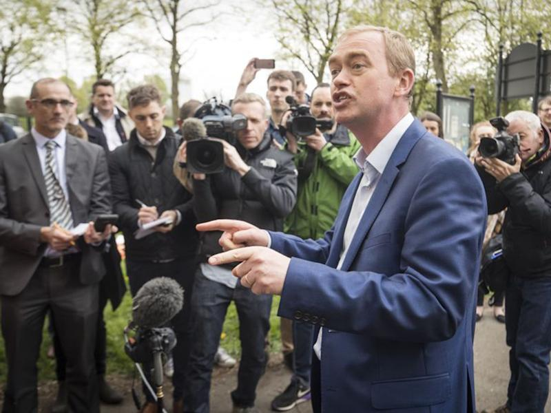 An enthusiastic Tim Farron campaigning in Manchester: PA