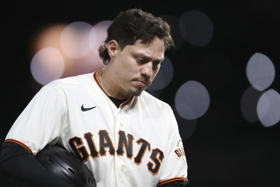San Francisco Giants' Wilmer Flores reacts after being thrown out at third base against the Los Angeles Dodgers during the sixth inning of Game 2 of a baseball National League Division Series Saturday, Oct. 9, 2021, in San Francisco. (AP Photo/Jed Jacobsohn)