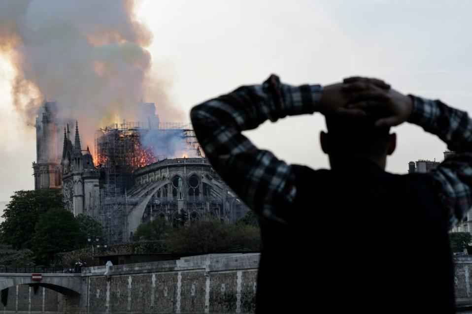 "<div class=""inline-image__caption""><p>A man watches the landmark Notre-Dame Cathedral burn, engulfed in flames, in central Paris on April 15, 2019. A huge fire swept through the roof of the famed Notre-Dame Cathedral in central Paris on April 15, 2019, sending flames and huge clouds of grey smoke billowing into the sky. The flames and smoke plumed from the spire and roof of the gothic cathedral, visited by millions of people a year. A spokesman for the cathedral told AFP that the wooden structure supporting the roof was being gutted by the blaze. </p></div> <div class=""inline-image__credit"">Geoffroy Van Der Hasselt/Getty</div>"