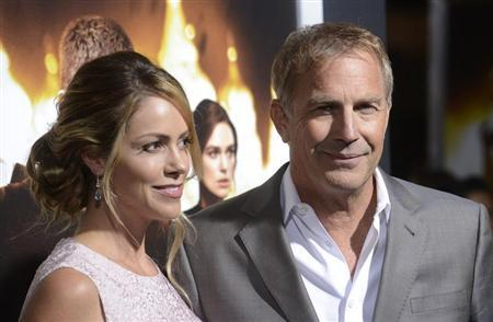 "Cast member Kevin Costner (R) and wife Christine Baumgartner attend the premiere of the film ""Jack Ryan: Shadow Recruit"" in Los Angeles January 15, 2014. REUTERS/Phil McCarten"