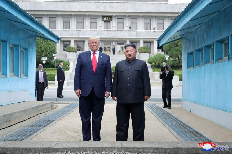 FILE PHOTO: Trump meets with North Korean leader Kim Jong Un at DMZ on border of North and South Korea
