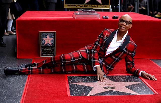 Television personality and drag queen RuPaul touches his star after it was unveiled on the Hollywood Walk of Fame in Los Angeles, California, U.S., March 16, 2018. REUTERS/Mario Anzuoni TPX IMAGES OF THE DAY