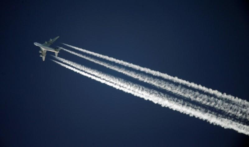 A Singapore Airlines Airbus A380 leaves contrails over the sky above Adelaide