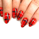 <em>Clueless</em> meets Christmas nails, could it get any chicer? The touch of gold makes it feel extra festive.