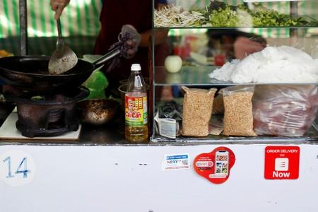 Mobile e-payment logos are see in an street food stall in Ho Chi Minh city in Vietnam