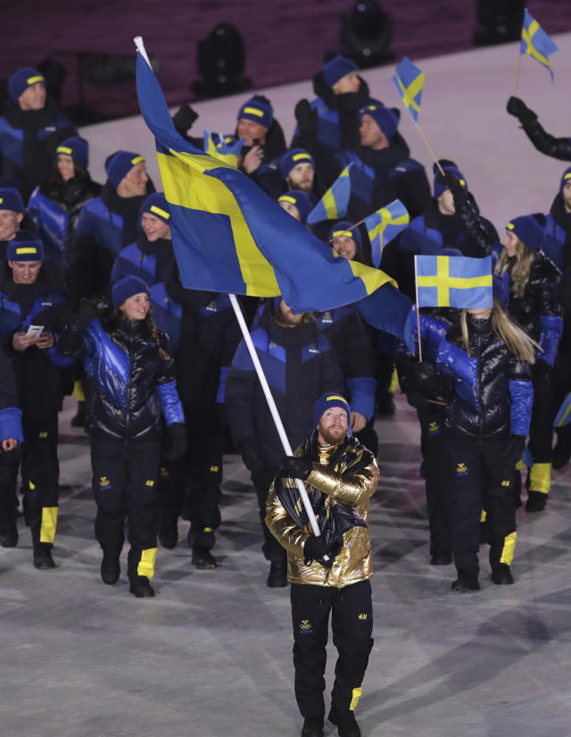 <p>Niklas Edin carries the flag of Sweden during the opening ceremony of the 2018 Winter Olympics in Pyeongchang, South Korea, Friday, Feb. 9, 2018. (AP Photo/Michael Sohn) </p>