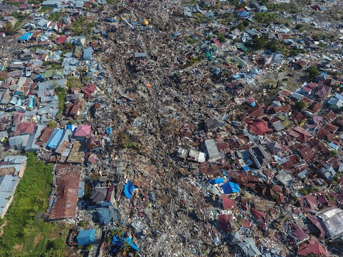 <p>An aerial view of an area devestated by an earthquake in Palu, Central Sulawesi, Indonesia Oct. 1, 2018. (Photo: Antara Foto/ Hafidz Mubarak A/ Reuters) </p>