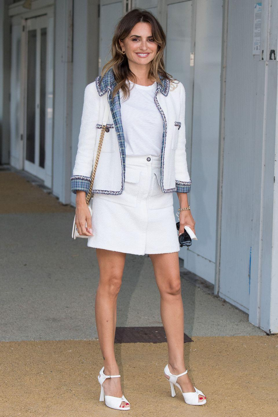 <p>Penelope Cruz posed in an all-white Chanel ensemble as she arrived for the film festival. </p>