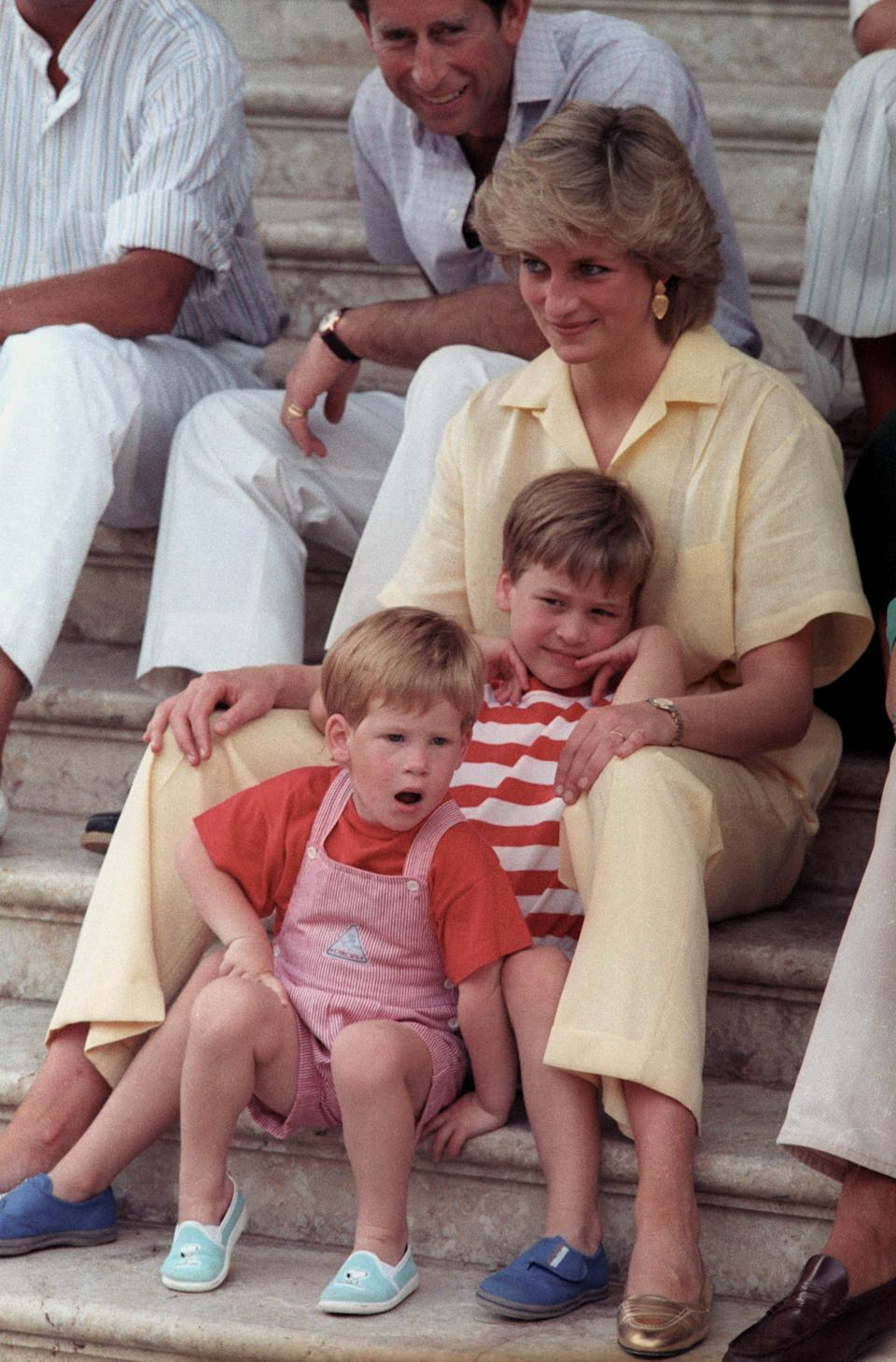 Princess Diana with her two sons Prince William, 6, and Prince Harry, 3, (front) as they pose during the morning's picture session on August 9, 1987 in Palma de Mallorca, Spain.  REUTERS/Hugh Peralta