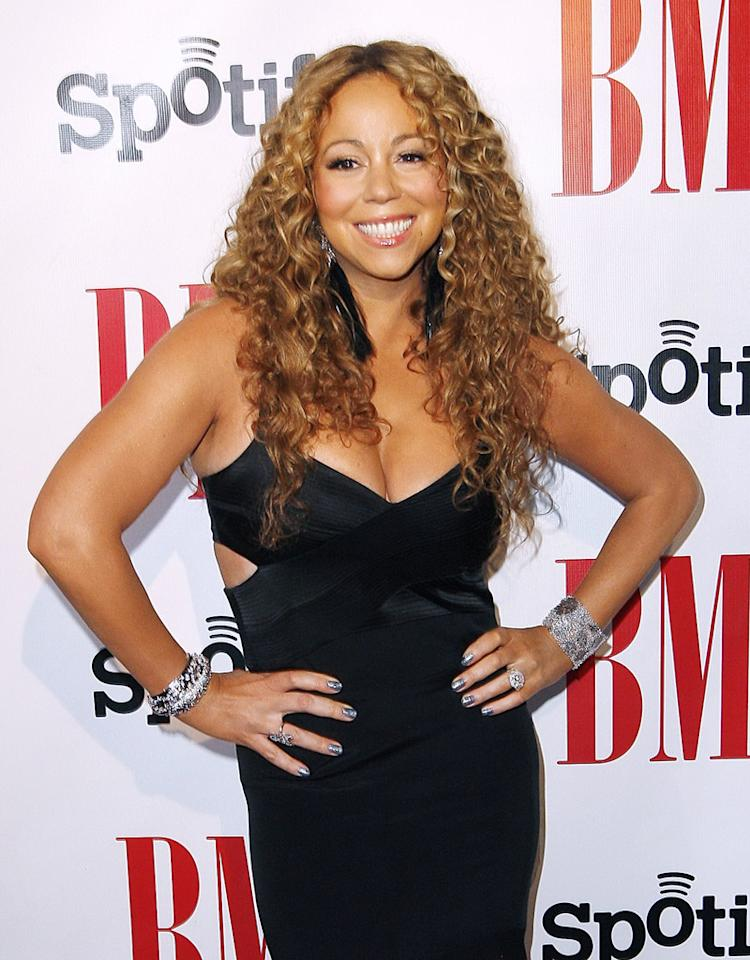 September 07, 2012: Mariah Carey honored at The 12th Annual BMI Urban Awards in Los Angeles, California. Her husband, Nick Cannon, joined Mariah on the red carpet where they shared a celebratory kiss.
