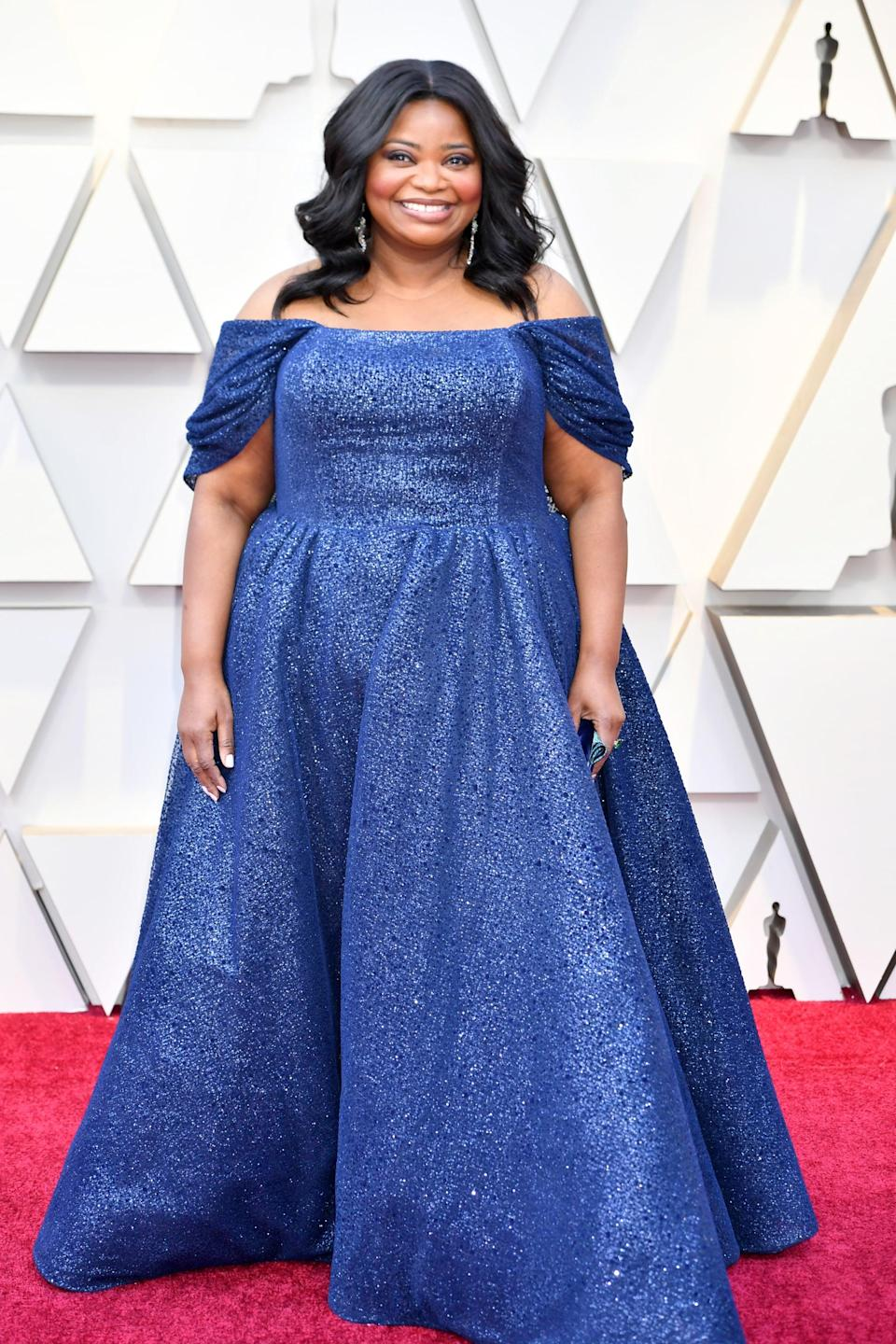 <p>Wearing a Christian Siriano gown with Lorraine Schwartz jewels and a Tyler Ellis clutch.</p>
