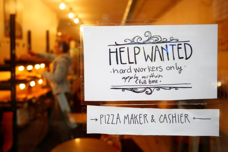 "A ""Help wanted"" sign is seen in the window of a bakery in Ottawa"