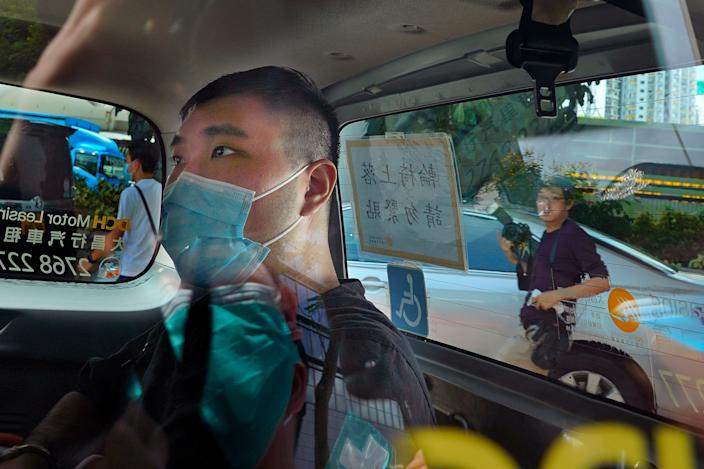 File: Tong Ying-kit arrives at a court in a police van in Hong Kong on 6 July, 2020 (AP)