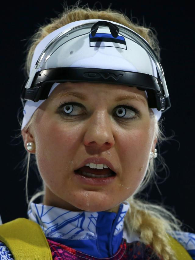 Estonia's Grete Gaim reacts after crossing the finish line during the women's biathlon 7.5km sprint event at the Sochi 2014 Winter Olympics in Rosa Khutor February 9, 2014. REUTERS/Carlos Barria (RUSSIA - Tags: SPORT BIATHLON OLYMPICS)