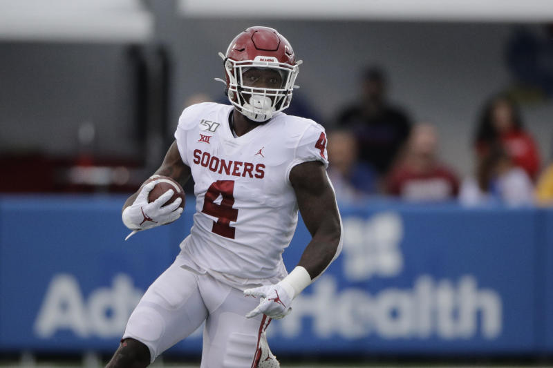 Oklahoma running back Trey Sermon runs during the first half of an NCAA college football game against Kansas Saturday, Oct. 5, 2019, in Lawrence, Kan. (AP Photo/Charlie Riedel)