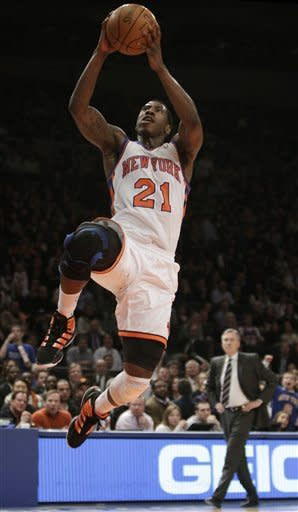New York Knicks head coach Mike D'Antoni watches from the floor as Knicks guard Iman Shumpert goes to the basket during the first half of an NBA basketball game against the Charlotte Bobcats at Madison Square Garden in New York, Monday, Jan. 9, 2012. (AP Photo/Kathy Willens)