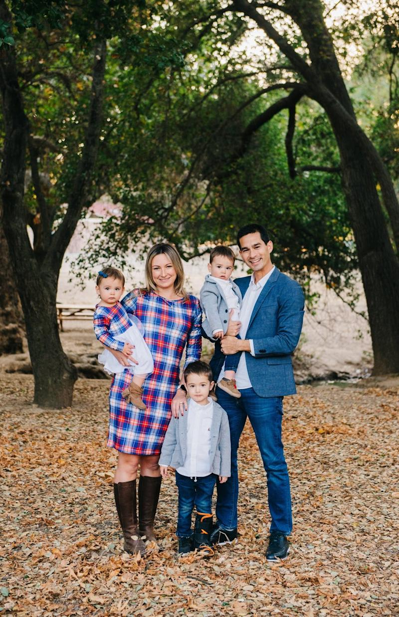 Nicole and Dan Oka with their children, Roman, and twins Dominic and Clara. The twins were unharmed when an Ikea bookcase tipped onto them in June.