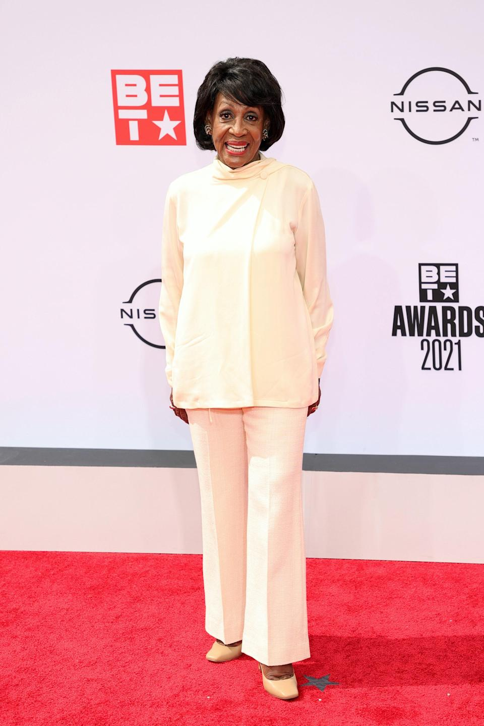 Truly reclaiming her time, Congresswoman Maxine Waters kept it clean and chic with her cream ensemble.