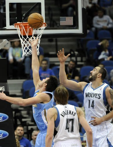 Denver Nuggets' Danilo Gallinari, left, of Italy, attempts a layup as Minnesota Timberwolves' Nikola Pekovic, right, of Montenegro, and Andrei Kirilenko, center, of Russia, look on in the first half of an NBA basketball game on Wednesday, Nov. 21, 2012, in St. Paul. (AP Photo/Jim Mone)