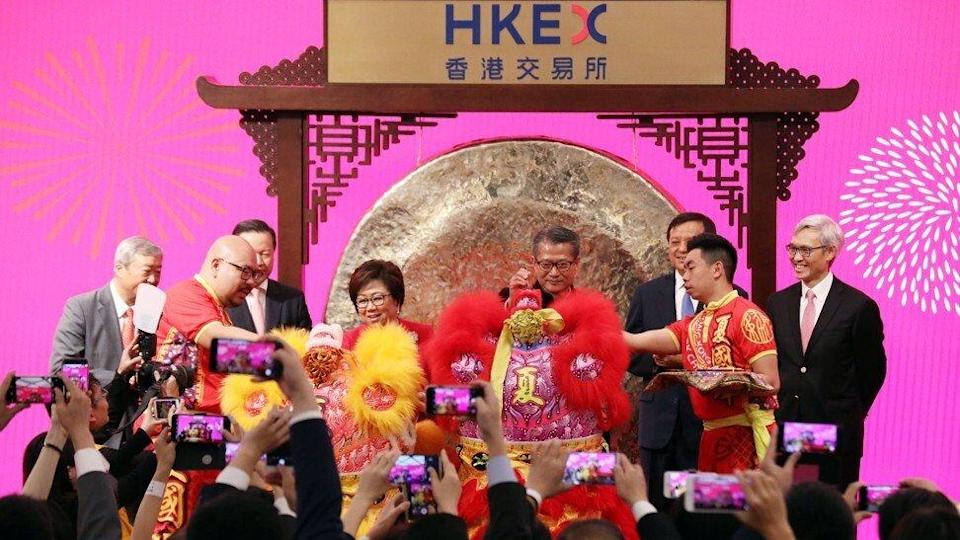Hong Kong Exchanges and Clearing (HKEX) Chairperson Laura Cha Shih May-lung (fourth left); and Hong Kong Exchanges and Clearing (HKEX) Chief Executive Charles Li Xiaojia (second right); attend the Ceremony to Mark the First Trading Day of the Lunar New Year at the HKEX in Central on February 8, 2019. Photo: Felix Wong