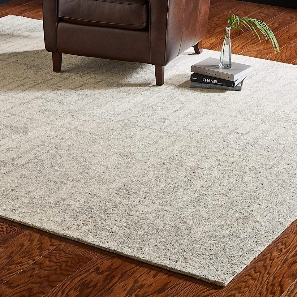 <p>This minimal <span>Rivet Contemporary Linear Distressed Wool Area Rug</span> ($131-$439) is easy to put in any room.</p>