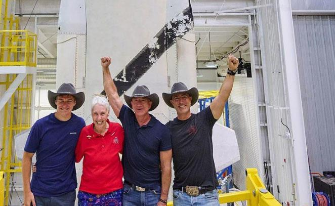 The New Shepard spacecraft's first crew (left to right): Oliver Daemen, aviation pioneer Wally Funk, Jeff Bezos and brother Mark Bezos. Launch on a 10-minute sub-orbital spaceflight is targeted for 9 a.m. EDT Tuesday. Two more passenger flights are expected before the end of the year. / Credit: Blue Origin