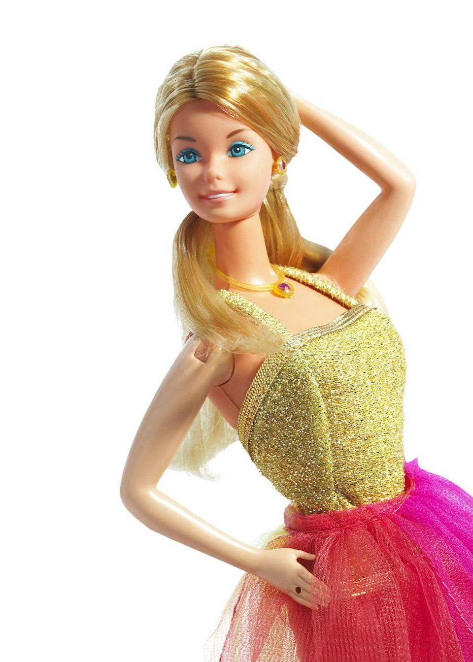 <p>Though she's been a model in every decade, the 1977 Fashion Model Barbie is a favorite for her colorful ensemble. </p>