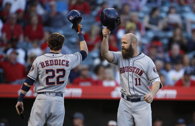 Houston Astros' Evan Gattis, right, celebrates his two-run home run with Josh Reddick during the second inning of the team's baseball game against the Los Angeles Angels on Wednesday, May 16, 2018, in Anaheim, Calif. (AP Photo/Jae C. Hong)