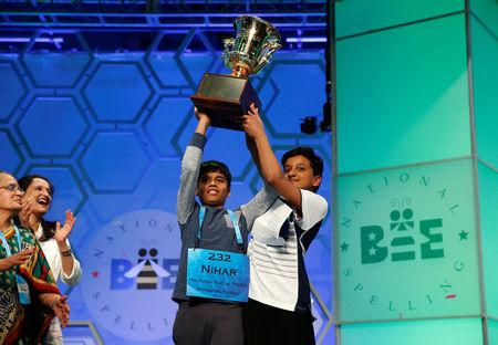 FILE PHOTO -  Co-champions Nihar Saireddy Janga and Jairam Jagadeesh Hathwar hold their trophy upon completion of the final round of Scripps National Spelling Bee at National Harbor in Maryland