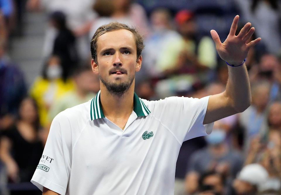 Daniil Medvedev waves to the U.S. Open fans after beating Daniel Evans in the fourth round.
