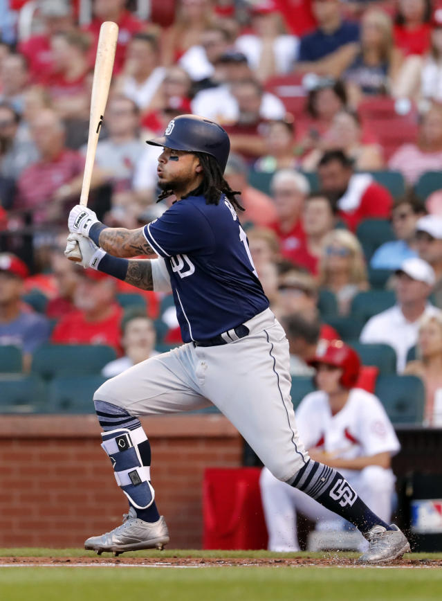 San Diego Padres' Freddy Galvis watches his two-run double during the first inning of a baseball game against the St. Louis Cardinals on Wednesday, June 13, 2018, in St. Louis. (AP Photo/Jeff Roberson)