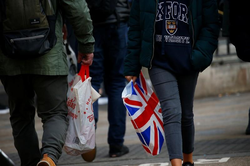 UK shoppers buy less, adding to slowdown signs for economy
