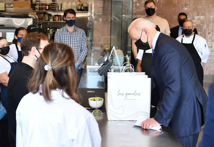 President Joe Biden orders food from Taqueria Las Gemelas (Twin Girls), a restaurant in northeast Washington, DC, to call attention to the Restaurant Revitalization Fund, which provides relief to bars and restaurants hit hard by the coronavirus pandemic. Las Gemelas was a beneficiary of funding.