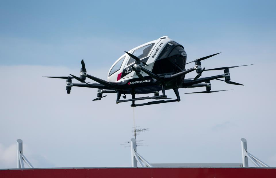 """An unmanned Air Taxi EHANG 216 takes off during a press preview of FACC AG on """"Urban Air Mobility"""" at Generali Arena in Vienna, Austria on April 4, 2019. - China's EHANG and Austrian FACC AG plan to produce 300 Taxi drones by 2020. (Photo by JOE KLAMAR / AFP)        (Photo credit should read JOE KLAMAR/AFP via Getty Images)"""