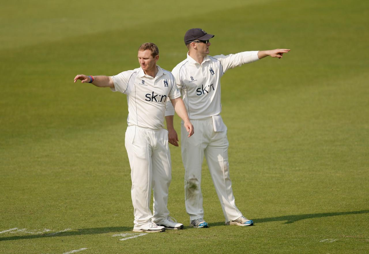LONDON, ENGLAND - MAY 24: Darren Maddy (L) and Jim Troughton (R) of Warwickshire gesture in the field during day two of the LV County Championship division one match between Surrey and Warwickshire at The Kia Oval on May 24, 2012 in London, England.  (Photo by Harry Engels/Getty Images)