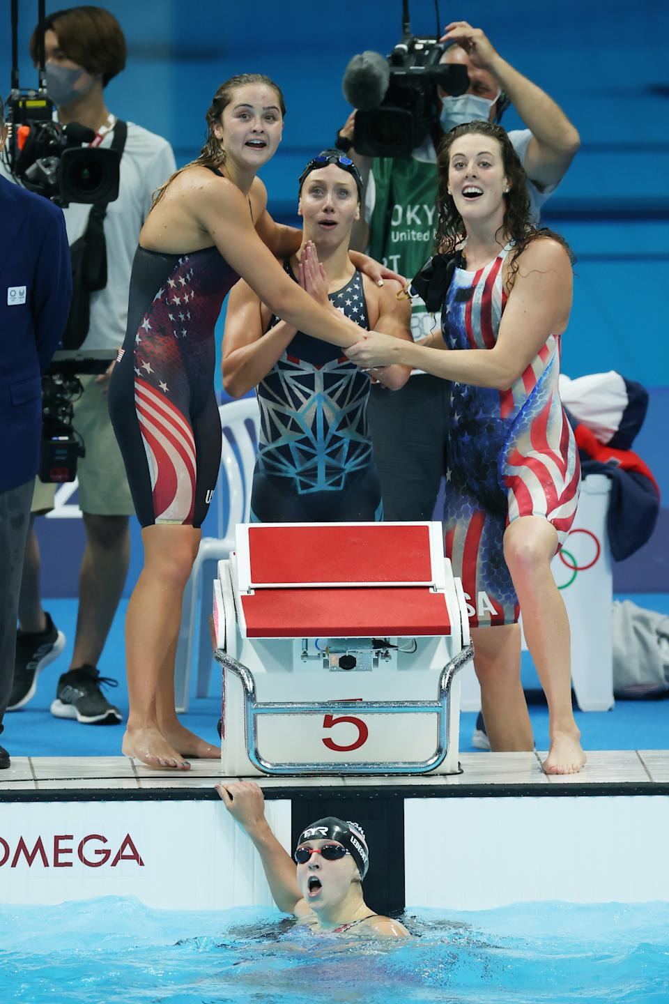 <p>TOKYO, JAPAN - JULY 29: Kathryn McLaughlin, Paige Madden, Allison Schmitt and Katie Ledecky of Team United States react after winning the silver medal in the Women's 4 x 200m Freestyle Relay Final on day six of the Tokyo 2020 Olympic Games at Tokyo Aquatics Centre on July 29, 2021 in Tokyo, Japan. (Photo by Alexander Hassenstein/Getty Images)</p>