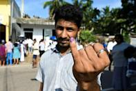 A man shows his inked finger after voting in the Sri Lankan presidential election