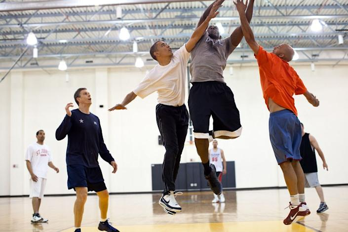 """President Obama tries to block a layup shot by his former personal aide, Reggie Love, at Fort McNair in Washington, D.C., May 16, 2010. (Pete Souza / The White House) <br> <br> <a href=""""http://lightbox.time.com/2012/10/08/pete-souza-portrait-of-a-presidency/#1"""" rel=""""nofollow noopener"""" target=""""_blank"""" data-ylk=""""slk:Click here to see the full collection at TIME.com"""" class=""""link rapid-noclick-resp"""">Click here to see the full collection at TIME.com</a>"""